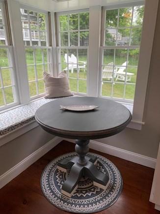 Vineyard Haven Martha's Vineyard vacation rental - A small kitchen breakfast nook overlooks the backyard seating