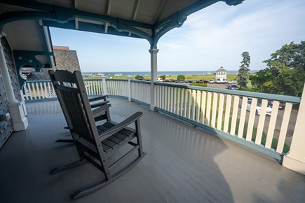 Heart of Oak Bluffs Martha's Vineyard vacation rental - Upstairs porch with view over park to the ocean.