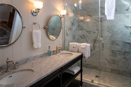 Heart of Oak Bluffs Martha's Vineyard vacation rental - Master bathroom with marble countertops and dual sinks.