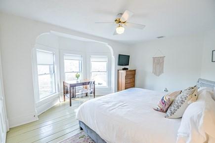 Oak Bluffs Martha's Vineyard vacation rental - Upstairs king bedroom w/ ceiling fan, bow window, desk, cable tv