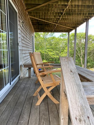 Aquinnah, Tashtego's Tree House Martha's Vineyard vacation rental - Private deck with partial water view off the master bedroom.