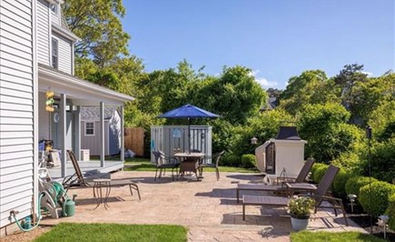 Edgartown Martha's Vineyard vacation rental - Side patio and deck w/ fireplace, table, and outdoor shower
