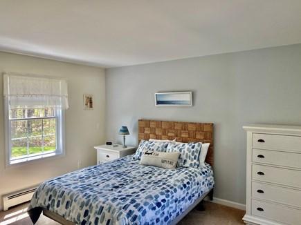 Edgartown Martha's Vineyard vacation rental - 1st floor master bedroom with Queen sleep-number bed and TV
