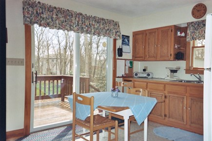 Vineyard Haven Outside of down Martha's Vineyard vacation rental - Kitchen - Dining Area with sliding door to the Outside Deck.