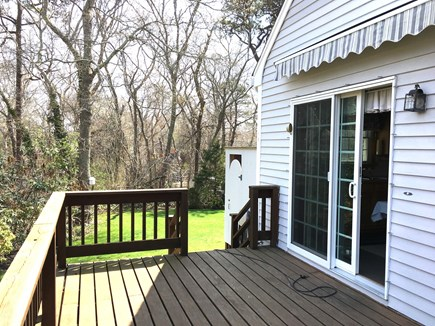 Vineyard Haven Outside of down Martha's Vineyard vacation rental - Outside Deck with sliding door into the home.