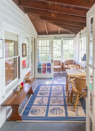 Oak Bluffs, East Chop Martha's Vineyard vacation rental - Sun porch. Shelves with games, books, kid activities.