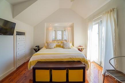 Oak Bluffs, #CozyBluffs Martha's Vineyard vacation rental - Master bedroom with sliding doors to small balcony