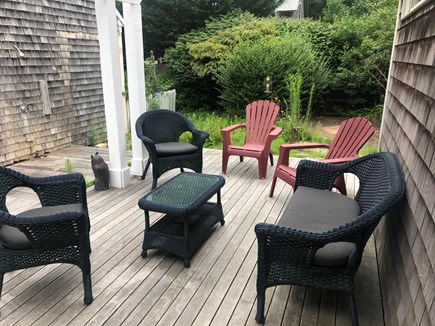 Oak Bluffs Martha's Vineyard vacation rental - Back deck with seating & gas grill, outdoor dining table in yard