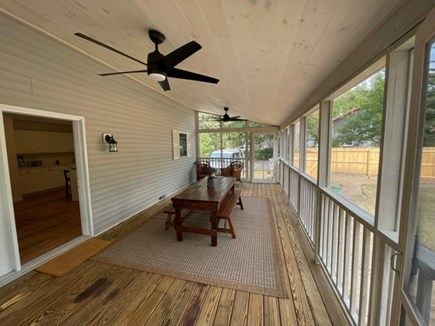 Oak Bluffs Martha's Vineyard vacation rental - Covered, screened in porch with antique farmers table