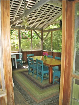 Chilmark Martha's Vineyard vacation rental - Screened in porch with couch and two tables