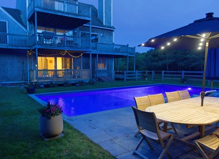 Katama - Edgartown, Edgartown Martha's Vineyard vacation rental - Night view of pool for evening swim. Table - with lit up umbrella