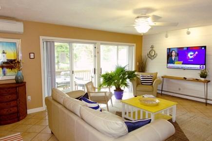 Katama - Edgartown, Edgartown Martha's Vineyard vacation rental - Family room with lg TV & deck leading to swimming pool.