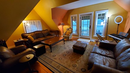 Oak Bluffs Martha's Vineyard vacation rental - Top floor living room featuring a small porch with beach view