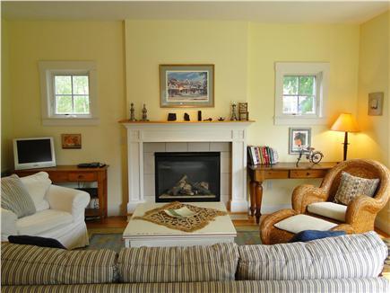 Edgartown Martha's Vineyard vacation rental - Living room with fireplace, door to backyard