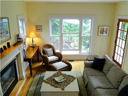 Edgartown Martha's Vineyard vacation rental - Living room with patio view and door backyard