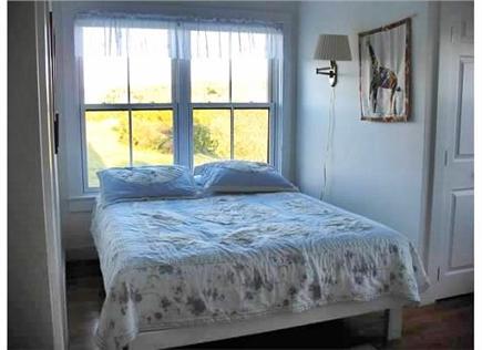 Edgartown Martha's Vineyard vacation rental - Second floor Southeast  queen bed set in window with water view