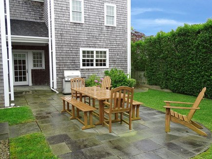 Mid-island, Nantucket, MA Nantucket vacation rental - Backyard blue-stone patio with table, grill and privacy hedges