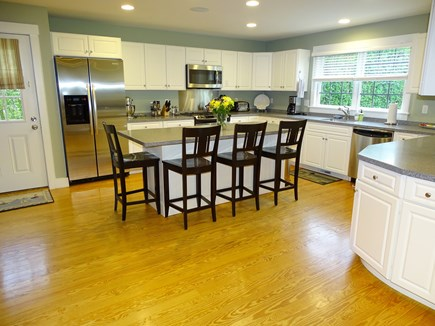 Mid-island, Nantucket, MA Nantucket vacation rental - Kitchen with stainless steel appliances, seating at island