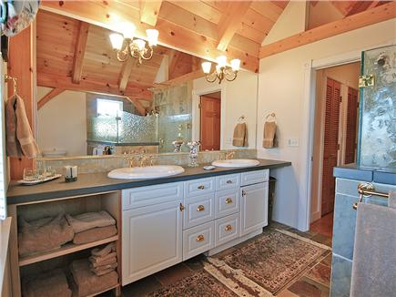 Siasconset Nantucket vacation rental - Master bathroom with vanity and 5' mirror with ample lighting.