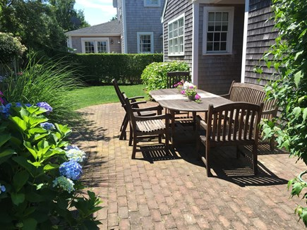 Mid-island - Naushop Nantucket vacation rental - Private backyard w/ outdoor speakers and firepit