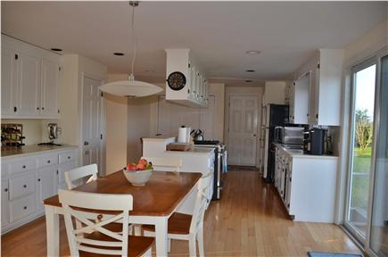 Cisco - Miacomet, Adjacent to Miacomet Golf Nantucket vacation rental - Kitchen and dining area with sliders to deck