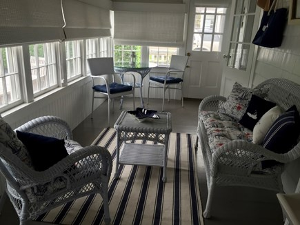 Siasconset Nantucket vacation rental - Sun porch with cafe tale and seating overlooking patio