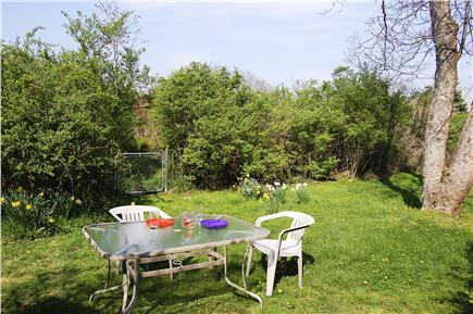Nantucket town, Cliff Rd Nantucket vacation rental - The spacious back yard with a gate to our wooded area behind