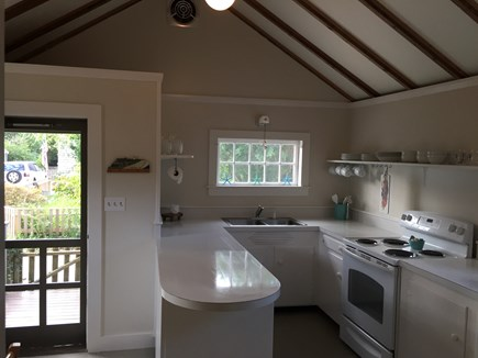 Siasconset Nantucket vacation rental - North Kitchen has seating for four and doorway to fenced yard.