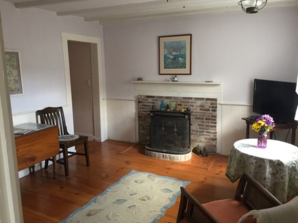 Siasconset Nantucket vacation rental - South Living Room with sitting area and dining table.