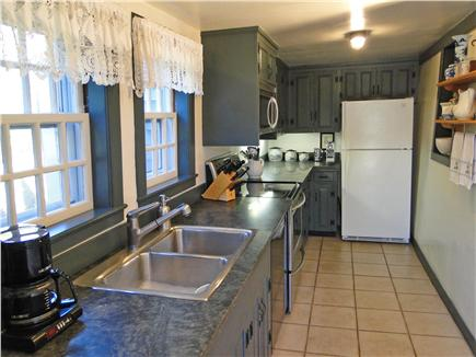 Nantucket town Nantucket vacation rental - Kitchen area off dining room with door to back patio, grill