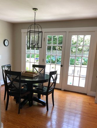 Mid-island, Naushop Nantucket vacation rental - Dining area with french doors to patio and backyard