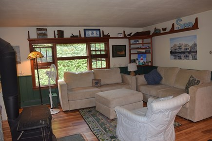 Mid-island Nantucket vacation rental - Enter into the living area with dining/kitchen to right.