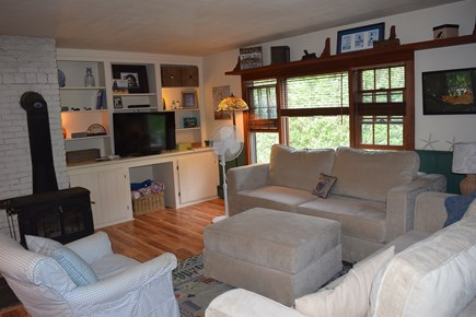 Mid-island Nantucket vacation rental - Living room with woodburning stove & Sactional couches.