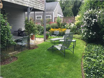 Nantucket Town Nantucket vacation rental - Back yard with porch, grill, dining table and lounge chairs