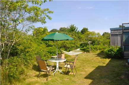 Surfside Nantucket vacation rental - Back yard, umbrella, chairs and table