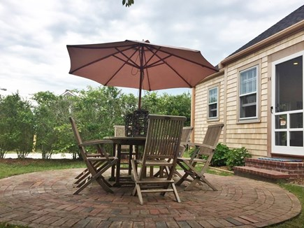 Nantucket town Nantucket vacation rental - Front of house with teak furniture and brick patio. Hammock too.