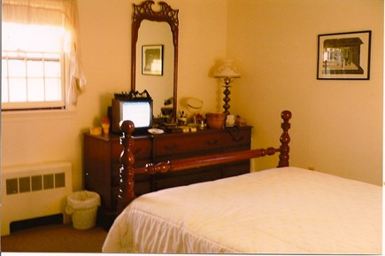 Mid-island Nantucket vacation rental - Master bedroom, a good queen mattress, chair, dresser, TV.