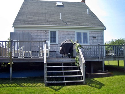 Mid-island Nantucket vacation rental - Back deck: outdoor shower, grill, lounges, overlooks pond