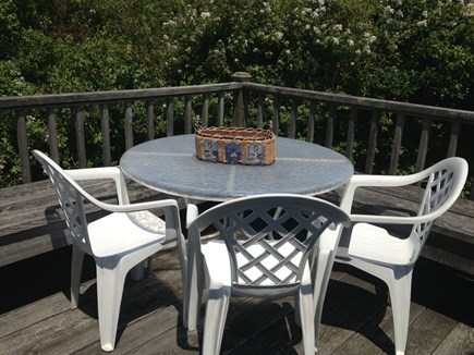 Mid-island Nantucket vacation rental - Back deck: table, chairs, benches, gas grill