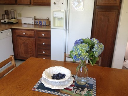 Mid-island Nantucket vacation rental - Hydrangea and blackberries grace the table in August.