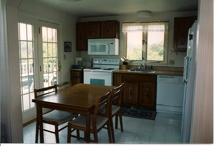 Mid-island Nantucket vacation rental - Kitchen: table, 4 chairs, microwave, coffee pot, door to deck