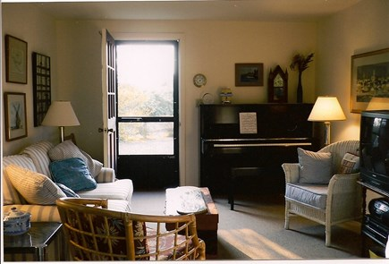 Mid-island Nantucket vacation rental - Living room: love seat, chairs, piano, TV, view conservation land