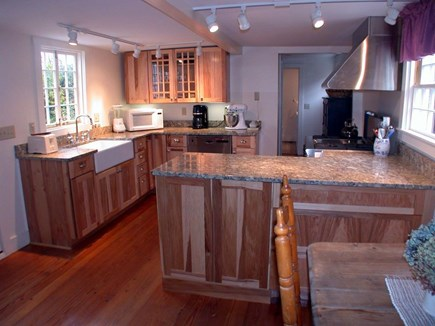 Nantucket town, Nantucket Nantucket vacation rental - View of kitchen from living room toward utility room at far end