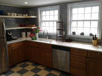 Siasconset Nantucket vacation rental - Remodeled Kitchen with quartz, stainless and open shelving.