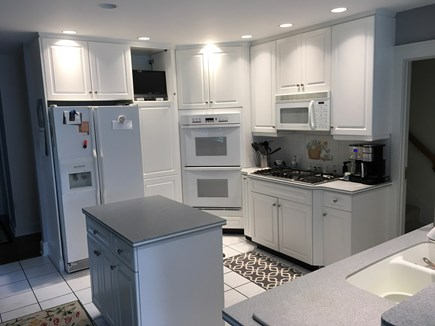 Surfside Nantucket vacation rental - Large kitchen with gas cook top, double ovens, and microwave