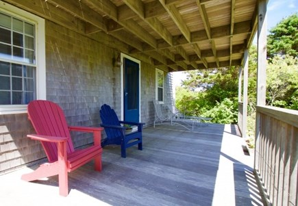 Surfside Nantucket vacation rental - Secluded lower covered  porch facing front lawn and ocean