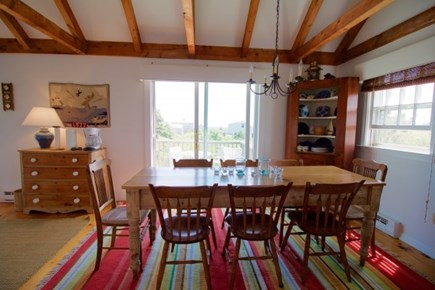Surfside Nantucket vacation rental - Dining area. Table seats eight. Linens, flatware, dishes, crystal