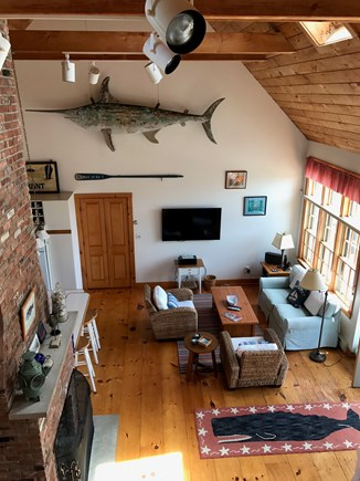 Madaket Nantucket vacation rental - A view from the loft shows the wide open living room.