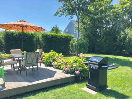 Nantucket Town  Nantucket vacation rental - Beautifuly landscaped yard and deck with seating and grill
