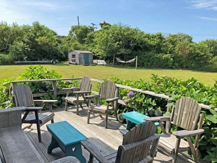 Old Madaket Nantucket vacation rental - Inviting porch overlooking yard, playhouse and hammock.